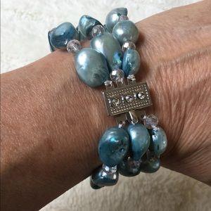 Jewelry - Triple Strand pearl bracelet. Silk bag included